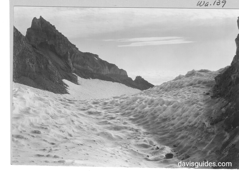 Honeycombed snow fields near Camp Muir, Little Tahoma on left. Mount Rainier National Park, 1932.