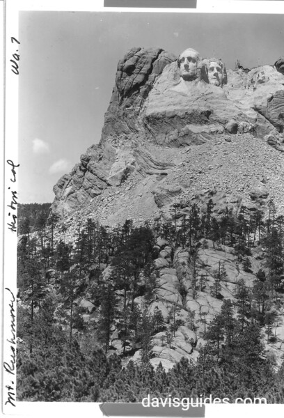 Heads of Washington and Jefferson. Men are working on head of Lincoln on the right. Mount Rushmore National Memorial, 1936.
