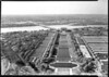 The National Mall as it appeared during World War II, showing the Memorial Bridge, Lincoln Memorial, Reflecting Pool, and the Navy Annex and Barracks. Note the bridge over the reflection pool. Arlington farm is visible in the upper left of the image. Photograph probably taken from top of Washington Monument. National Mall, 1943.