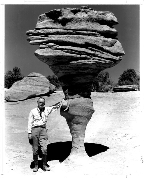 George Grant beside a rock formation, Natural Bridges National Monument, 1935. Photograph by Grant's photography assistant, Zeke Johnson.