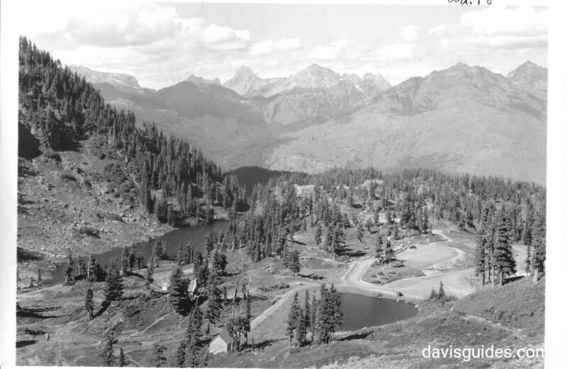 View north from Kulshan Bridge road, showing the Mount Baker Lodge area. The distant mountains are very close to the Canadian border. Future North Cascades National Park, 1937.