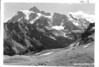 Mount Shuksan from Kulshan Bridge showing part of the new highway grade. Future North Cascades National Park, 1937.