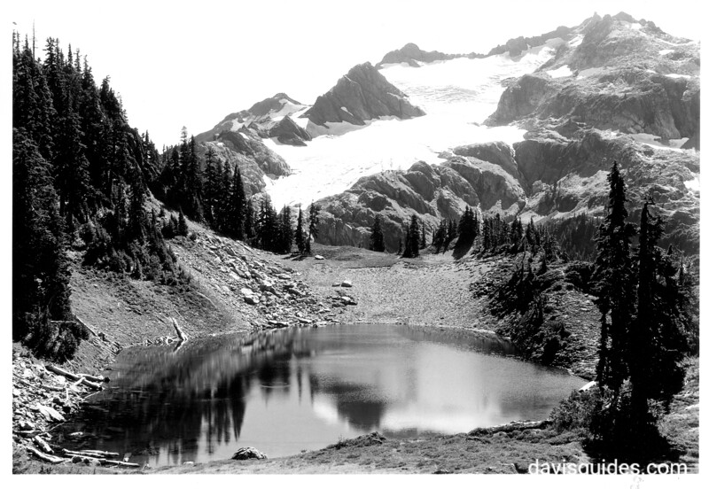 One of the beautiful lakes in Martin's Peak area. Above is the De La Barre Glacier on the east side of Mount Christie. Proposed Olympic National Park, 1934.