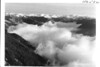 Olympic Mountains above the clouds below Hurricane Ridge. Olympic National Park, 1938.