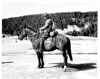 George Grant on horseback preparing for a trip into the backcounty. Yellowstone National Park, 1933. (note the camera case on his hip and the tripod strapped to his saddle.)