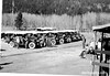 CCC enrollees preparing to travel in red tourist buses to work project site. Rocky Mountain National Park, 1933.