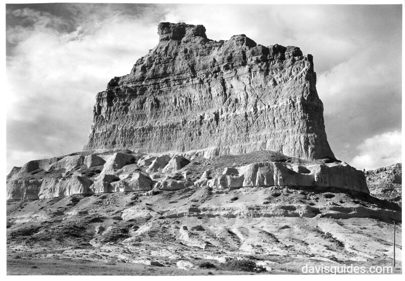 A bluff on a cliff on the north side of the Mitchell Pass summit - the southern extremity of the north plateau of Scotts Bluff. The Oregon Trail crossed the summit in the foreground. Scotts Bluff National Monument, 1932.