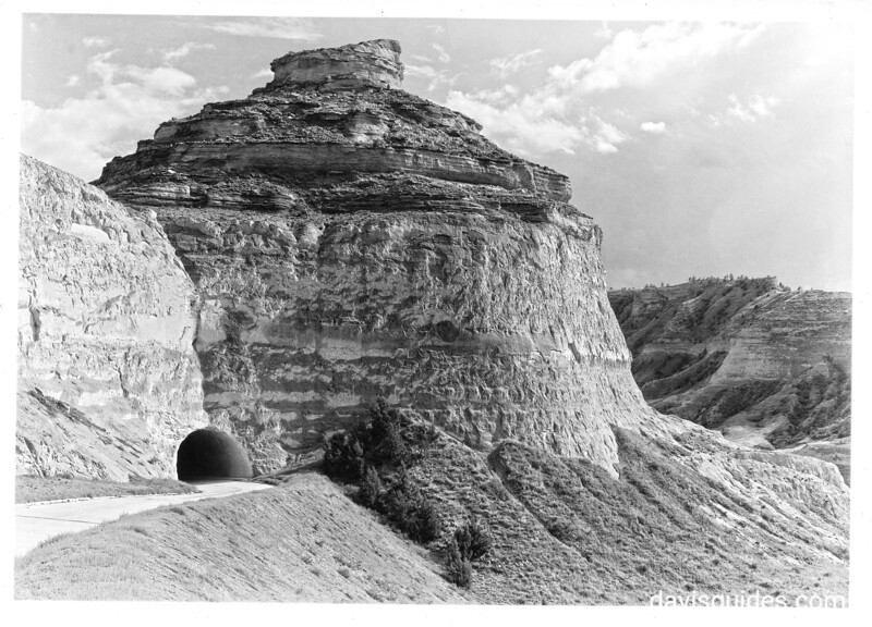 The spectacular bluff on the north side of Mitchell Pass. The road leads from the headquarters to the top of the bluff. Scotts Bluff National Monument, 1938.