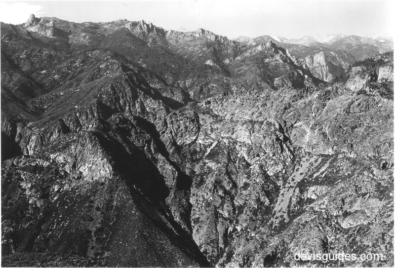 From lookout point south of Hume Lake, looking at Tehipite Dome (right) on north side of Middle Fork of Kings River Canyon. Sequoia and Kings Canyon National Parks, 1940.