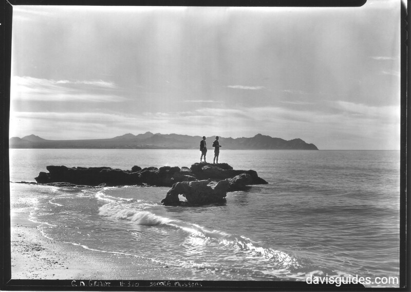 Expedition members on rocks overlooking Gulf of California. Sonora Mission Expedition, 1935.