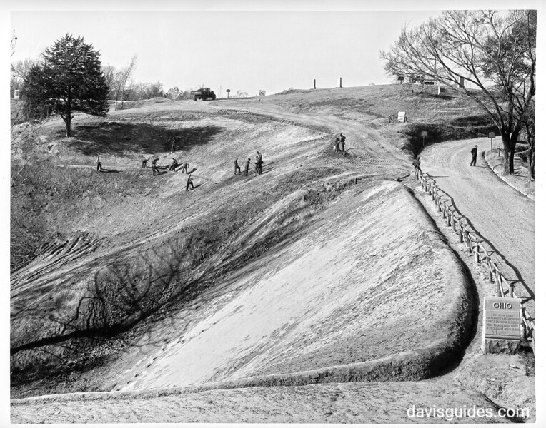 CCC enrollees carrying on an erosion control operation along the Graveyard Road in front of Stockade Redan. Here huge gullies, which were eating their way toward the redan, have been filled in and sloped. Vicksburg National Military Park, 1934.