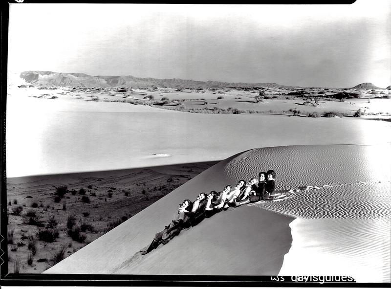 Gypsum slopes are ideal for sliding. White Sands National Monument, 1934.