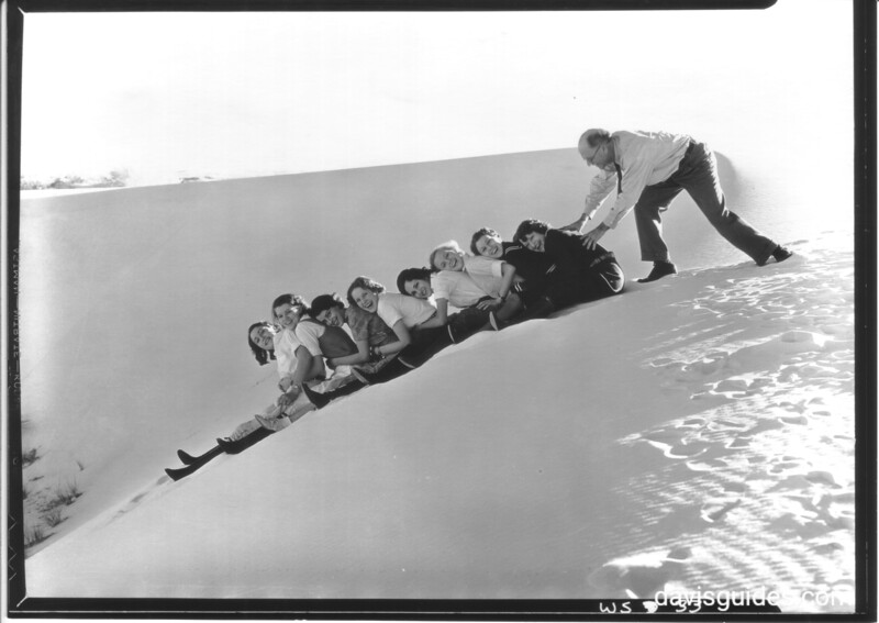 """""""Mister, give us a push!""""  Sliding on the dunes. White Sands National Monument, 1934."""