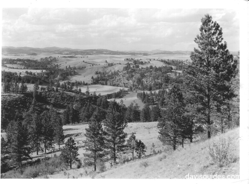 The typical 1/2 wooded, 1/2 plains area within the park. This view was made crestside of park near old Indian campground. Wind Cave National Park, 1936.