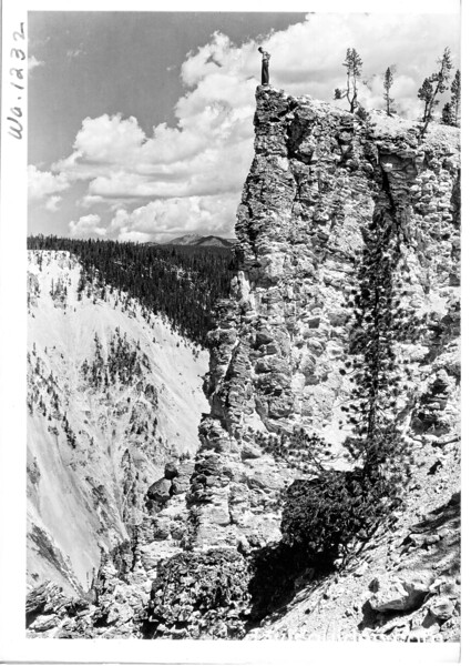 Rim of the bluff near Artist's Point in Yellowstone Canyon. It is not as dangerous as it looks.  Yellowstone National Park, 1936.