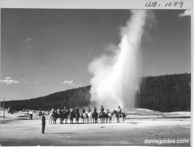 Horseback party viewing eruption of Old Faithful. Yellowstone National Park, 1933.