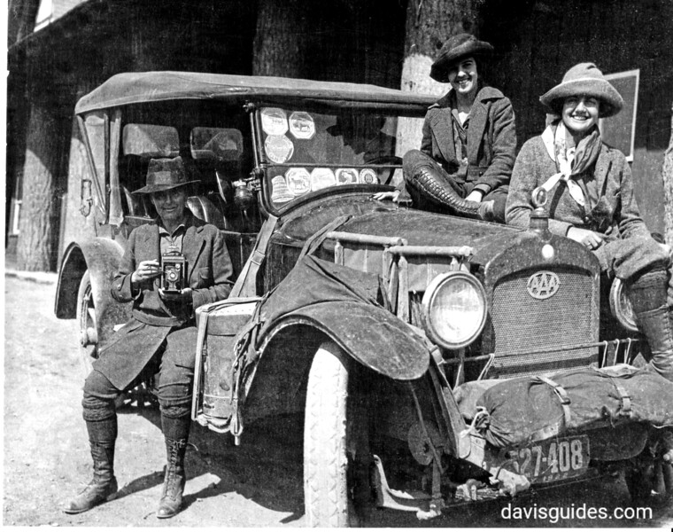 Mary Crehore Bedell and her daughters with their automobile. (The Bedell family reputed traveled more than 12,000 miles visiting parks and other destinations. Note the park decals on the auto windshield and the AAA medallion on the radiator.). Yellowstone National Park, 1922.