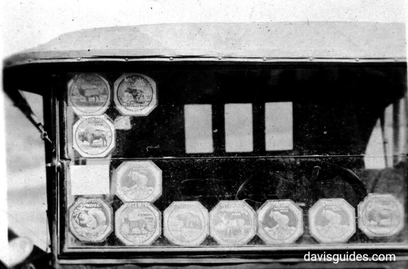 National Park stickers on automobile windshield. Yellowstone National Park, 1922. Uncredited photograph but believed to have been taken by George Grant.
