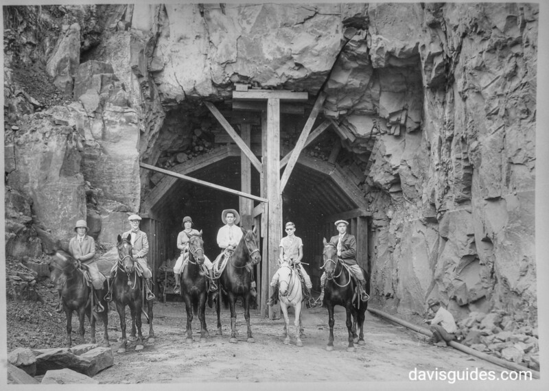 Horseback party at west entrance to Zion Tunnel. This tunnel will shorten the distance from Zion to Bryce by 70 miles, from Zion to the north rim of the Grand Canyon by __ miles. Zion National Park, 1929.