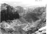 The Switchbacks of Mount Carmel Highway between the tunnel  and floor of Zion Canyon. Taken from a point over the Great Arch of Zion and the West Temple. Zion National Park, 1935.