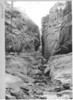 Horseback party on Echo Canyon on East Rim Trail. Pot holes along stream bed. Zion National Park, 1929.