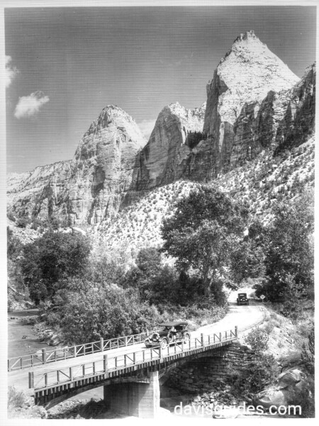 The Three Wise Men with the bridge over the Virgin River in the foreground.  Zion National Park, 1929.
