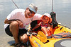 Grandpa takes Lanes for her first kayak ride