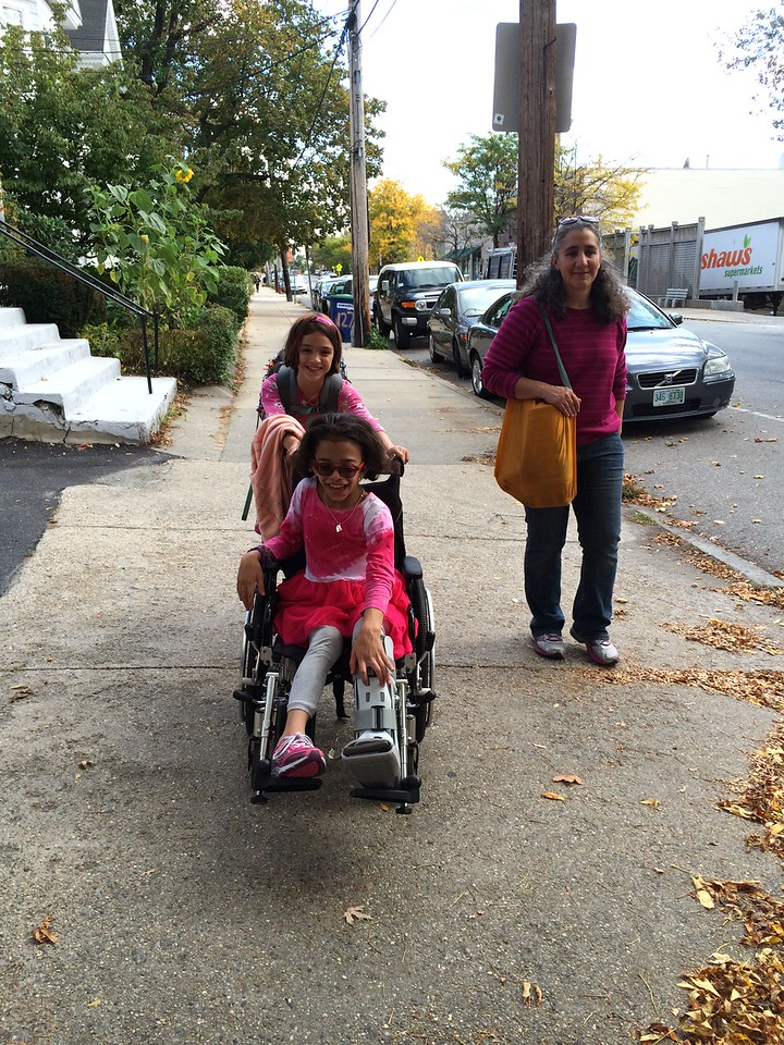 Guen helps Sara get to school.