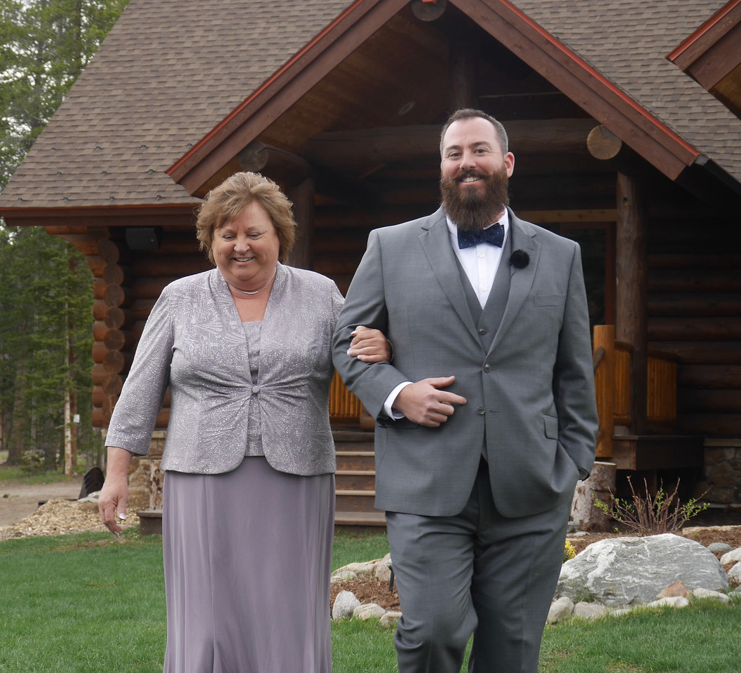 The Wedding - The dashing groom and his lovely Mom coming down the aisle.