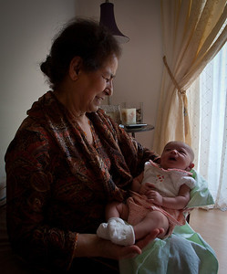 Aunty Sitara holding holding her granddaughter.  Leena would stop fussing instantly.