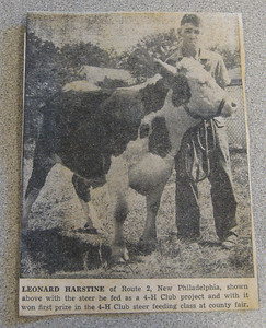 An old newspaper clipping showing Leonard with his 4-H steer.  (in 1940's)
