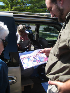 John, Ruthie, and John's grandson (son of Stanley) came from Kansas in this van.   Marj showed them a photo of an earlier family reunion.