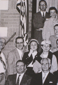 Lenny Harstine and his wife Phyllis (standing in front ot the flag) in historic photo of church members.