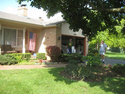 July 13, 2009. Uncle Len's house with bright flowers front and back, well maintained by Robert (right)