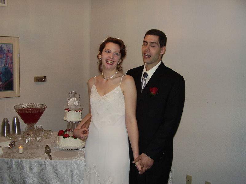 Lenora & Greg Roberts -- just before cutting the cake
