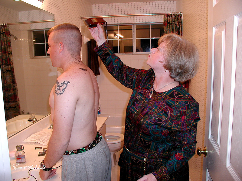 2000 Carol giving Logan a haircut