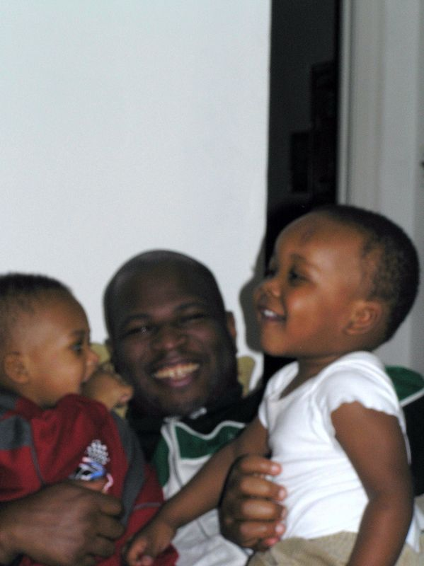 Little Sam and two of the five boys in Tracie's care.  So cute!
