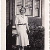 "Ida Krieger (Scheible) - 4th of July 1942 caption on back says: ""mom waiting for bus for work"""