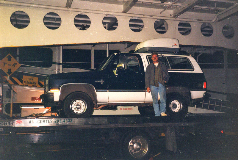 """DOUG AND THE BROKE TRUCK<br /> Unfortunately, on this trip, something in the ignition system went haywire and we couldn't keep the battery charged, so we had to get AAA to """"tow"""" us back to the island. The driver was a very good sport about it."""
