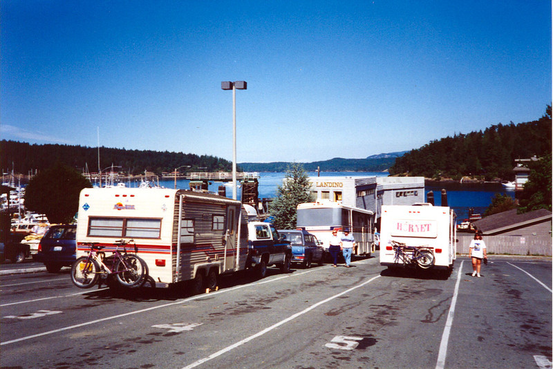 WAITING FOR THE FERRY<br /> Friday Harbor, Washington<br /> <br /> Well, here we are, in line and anxiously awaiting our ticket off this rock. That's our rig to the left in lane 3 and Roger and Maria's Hornet in lane 5.