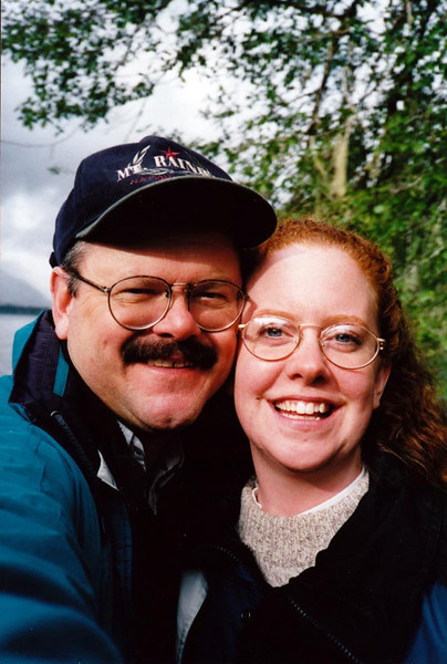"""DOUG AND LISA<br /> When last we saw our intrepid couple, they were cruising around Washington's Olympic Peninsula, where this picture was taken. (See my """"1995-1996 - Mt Rainier"""" gallery for full details.) We'll meet them once again at their somewhat Bohemian yard sale at the BP gas station's RV Park in Ashford, Washington, sneezing their fool heads off. Onward!"""
