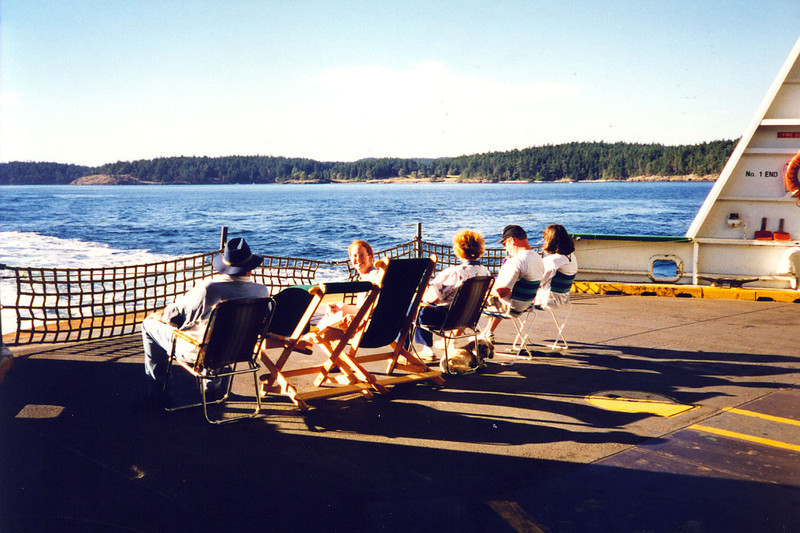 WATCHING THE ISLAND RECEDE<br /> We all got our various lawn chairs out to sit and watch San Juan Island fade into a dream as the ferry pulls away. A-a-a-a-h-h-h!!!