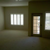 Main living area / Patio door - carpet & flooring will be replaced thru out unit -