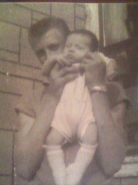 1961 - Uncle Billy Ray holding me (Janet) - this is the house my Mom and I lived in with my Gramma Mary, Papa Raymond, Uncle Billy Ray on a dairy in Red River County, Texas - notice the house had shingles for siding - we were very poor back then, but never short on love