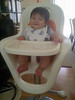 July 22, 2013:  We put together Lincoln's new high chair by Boon.  At this point, he wasn't very good at sitting up straight, and typically had a lean to the left or right.  <br /> <br /> In this photo, taken by my ancient Blackberry, he seems to enjoy the view.