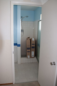 Master bath with new medicine cabinets waiting in their boxes.