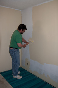 Pete painting one of the several tan walls.