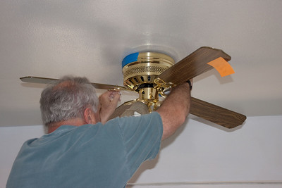 Paul masking the fan to paint the ceiling.