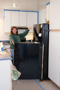 Sis and the new refrigerator! Yay, cold drinks for the volunteers.