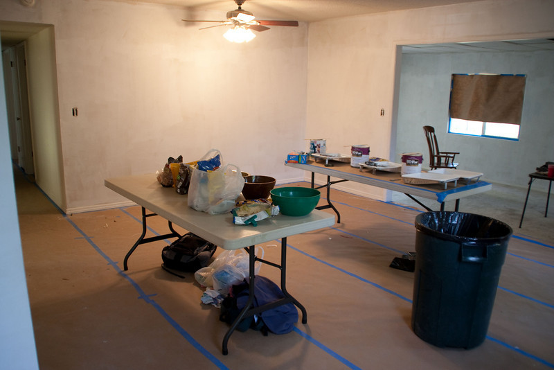 In the living/dining room, one table for paint and tools ,the other for food for the hungry volunteers.